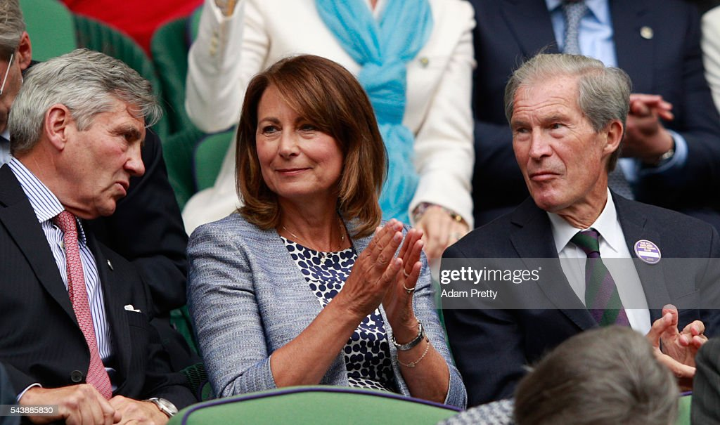 The Parents of Kate Middleton, Michael and Carole Middleton are in conversation with Anthony Henman, the farther of Tim Henman, as they watch on from the stands in centre court on day four of the Wimbledon Lawn Tennis Championships at the All England Lawn Tennis and Croquet Club on June 30, 2016 in London, England.