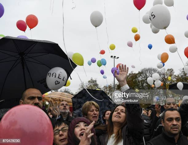 The parents of missing French girl Maelys de Araujo Jennifer and Joachim are joined by others as they set balloons free in Les AbretsenDauphiné...