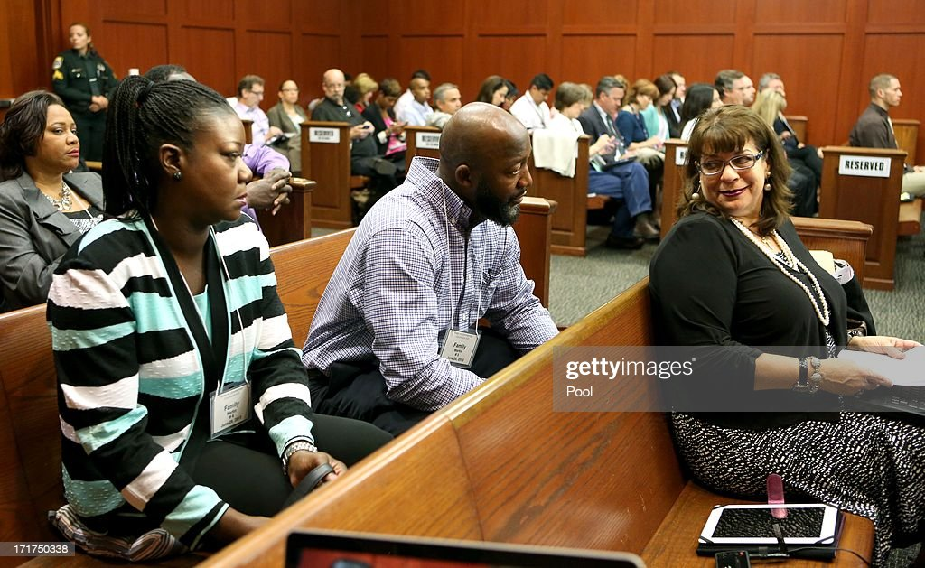 The parents of Trayvon Martin, Sybrina Fulton (L) and Tracy Martin (C) are greeted by State Attorney Angela Corey (R) after arriving for the 15th day of Zimmerman's murder trial in Seminole circuit court June 28, 2013 in Sanford, Florida. Zimmerman is charged with second-degree murder for the February 2012 shooting death of 17-year-old Trayvon Martin.