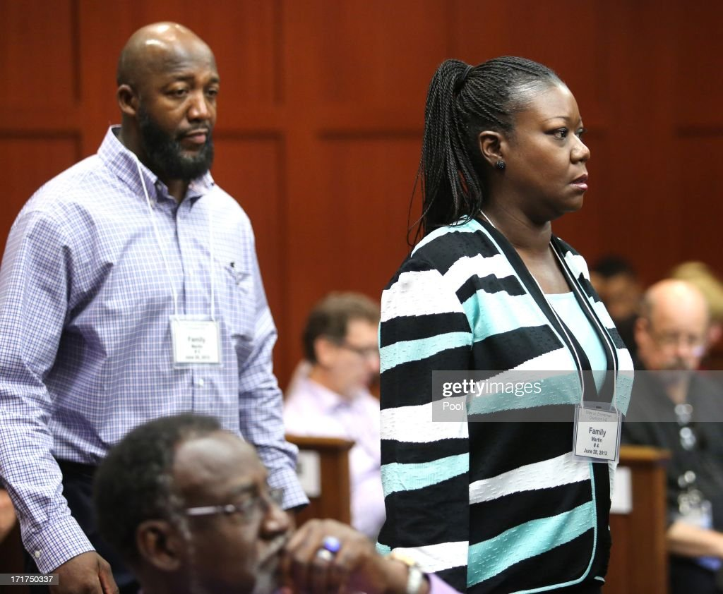 The parents of Trayvon Martin, Sybrina Fulton (R) and Tracy Martin (L) arrive for the 15th day of Zimmerman's murder trial in Seminole circuit court June 28, 2013 in Sanford, Florida. Zimmerman is charged with second-degree murder for the February 2012 shooting death of 17-year-old Trayvon Martin.