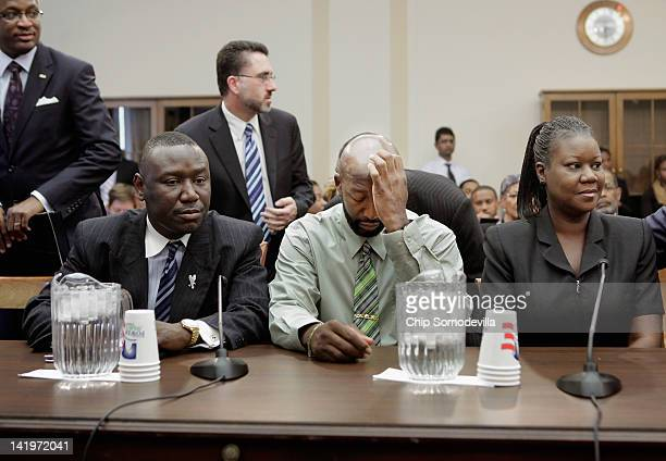 The parents of Trayvon Martin Tracy Martin and Sybrina Fulton and their attorney Benjamin Crump attend a House Judiciary Committee briefing in the...