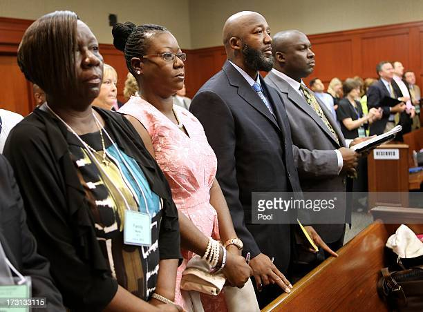 The parents of Trayvon Martin Tracy Martin and Sybrina Fulton stand for the jury on the 20th day of the George Zimmerman trial in Seminole circuit...