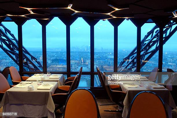 The Paris cityscape at dusk is viewed from the dining room of the Jules Verne Restaurant on the second floor of the Eiffel Tower in Paris France on...