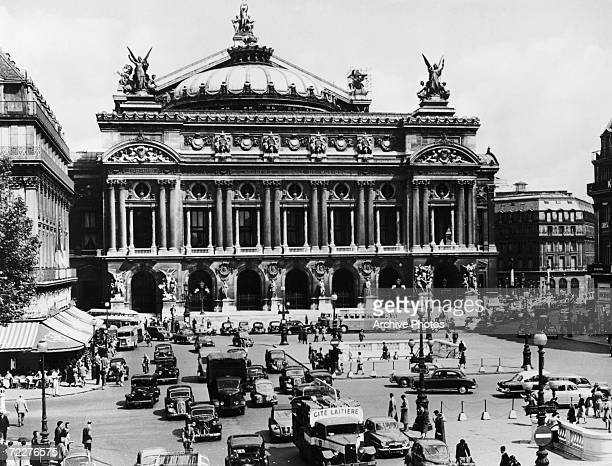 The Paris Opera House and traffic on the Place de l'Opera Paris circa 1955 Designed by architect Charles Garnier the opera house was completed in 1875