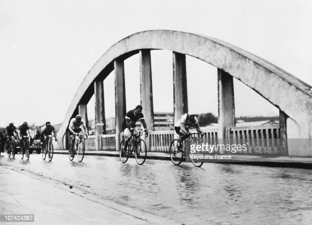 The Paris Roubaix Cycling Race Crossing A Bridge At Creil In France