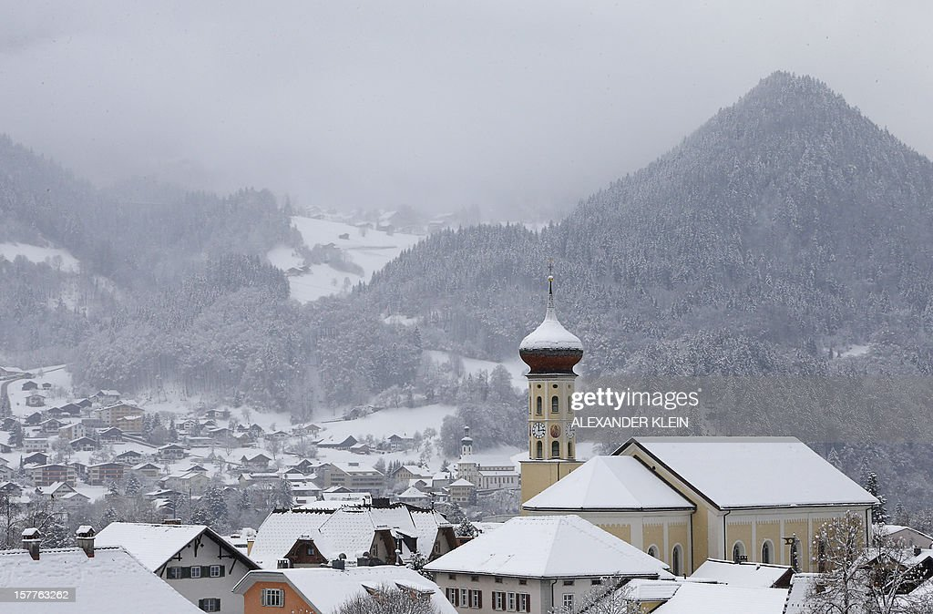 The Parish church Saint Jodok is seen under snowfalls in the village of Schruns on the Montafon valley, Austrian Alps, on December 6, 2012.