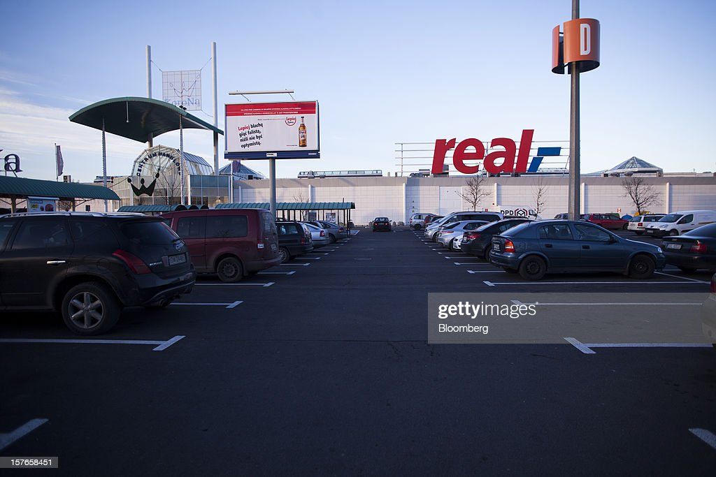 The parking lot is seen outside a Real supermarket in Wroclaw, Poland, on Wednesday, Dec. 5, 2012. Metro AG, Germany's biggest retailer, agreed to sell its Real grocery stores in eastern Europe to Groupe Auchan SA of France for 1.1 billion euros ($1.4 billion) in Chief Executive Officer Olaf Koch's first big deal since taking the helm. Photographer: Bartek Sadowski/Bloomberg via Getty Images
