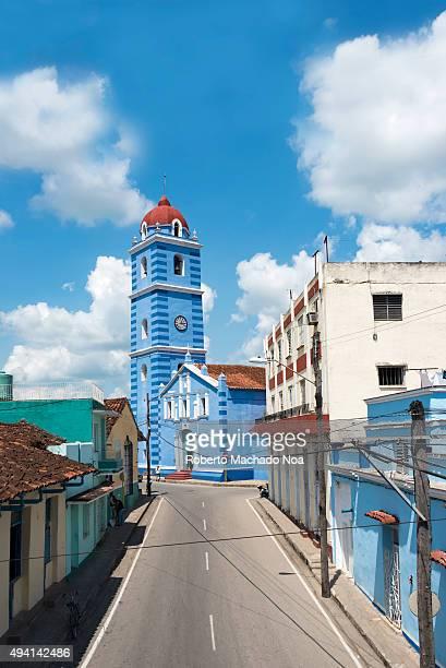 The Parroquial Mayor Cathedral or Iglesia Parroquial Mayor del Espiritu Santo in Sancti Spiritus Cuba The church has blue walls with a bell cum clock...