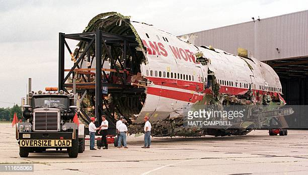 The partially reconstructed fuselage of TWA Flight 800 which crashed shortly after takeoff from JFK Airport in New York in August of 1996 is pulled...