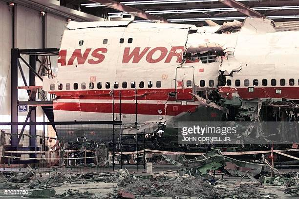 The partially reconstructed TWA flight 800 aircraft shows 08 July 1999 in Calverton NY the side of the plane where the center fuel tank reportedly...
