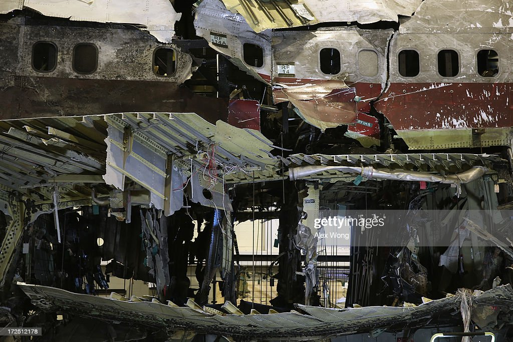 The partially reconstructed wreckage of the Trans World Airlines Flight 800 (TWA 800) sits in a hanger at the National Transportation Safety Board (NTSB) Training Center July 2, 2013 in Ashburn, Virginia. TWA 800 flight exploded shortly after takeoff on July 17, 1996 from John F. Kennedy International Airport, killing all 230 onboard and crashing into the Atlantic Ocean. Today, members of the media were invited back to review the wreckage and the details of the NTSB investigation.