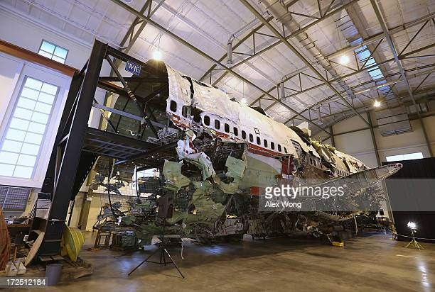 The partially reconstructed wreckage of the Trans World Airlines Flight 800 sits in a hanger at the National Transportation Safety Board Training...