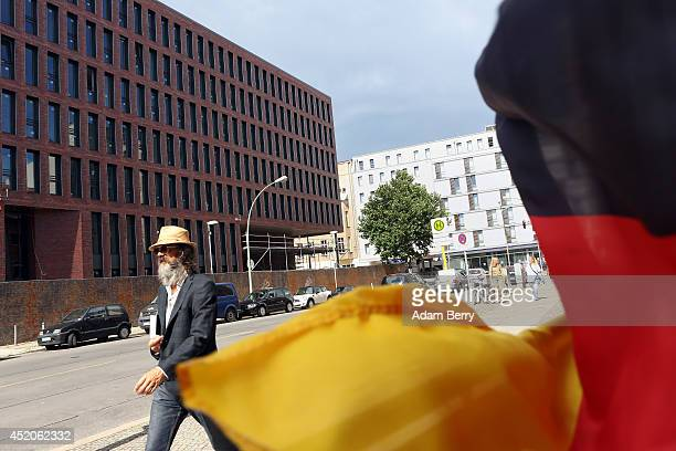 The partiallyfinished new headquarters building of Germany's Federal Intelligence Service the Bundesnachrichtendienst is seen behind a German flag on...