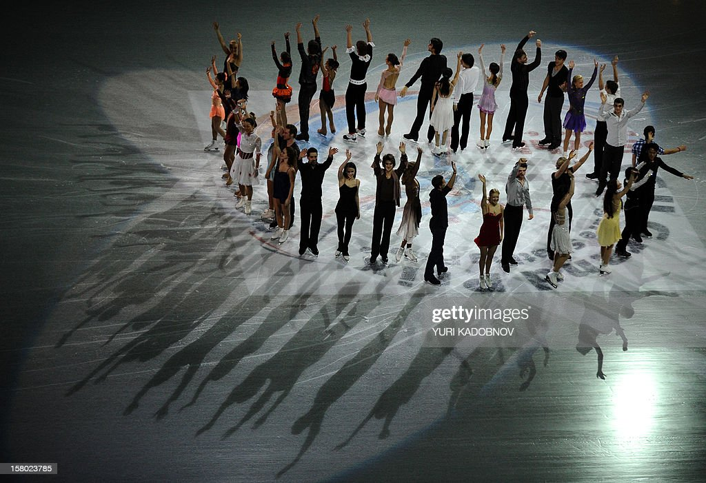 The participants of the ISU Grand Prix of Figure Skating Final acknowledge the applause from the audience during the gala-exhibition in Sochi on December 9, 2012.