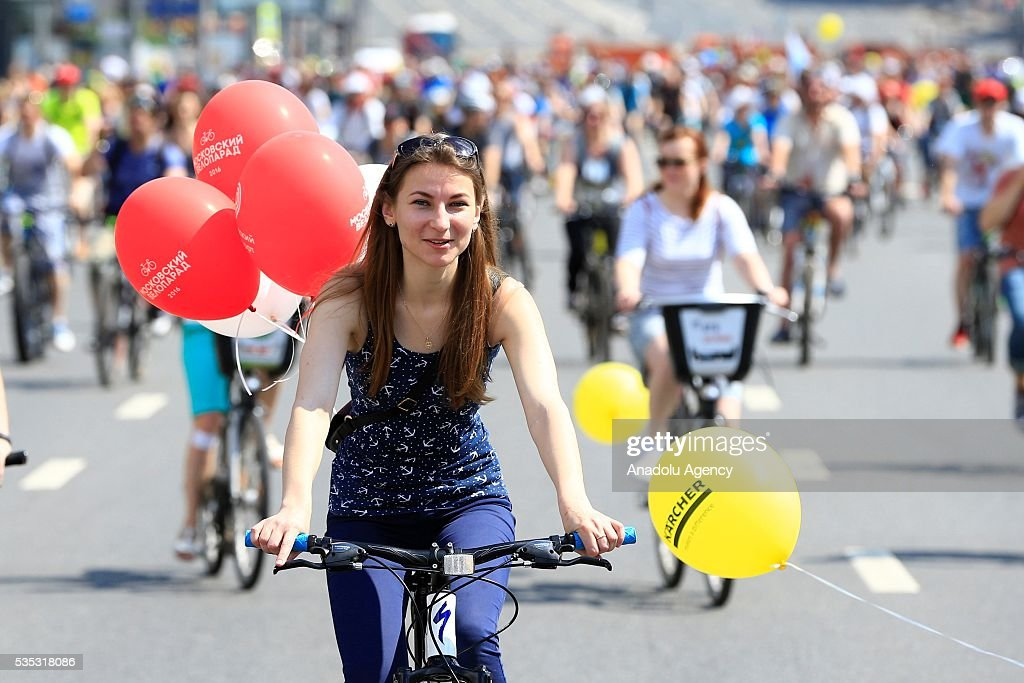 The participants ride their bicycles at the 6th Annual Moscow Bike Parade on Prospekt Akademika Sakharova, in Moscow, Russia, on May 29, 2016. The yearly event is organized by the Let's Bike It project, in Russia that bring together more than 30,000 people from across the country 16 kilometers route has been completed.