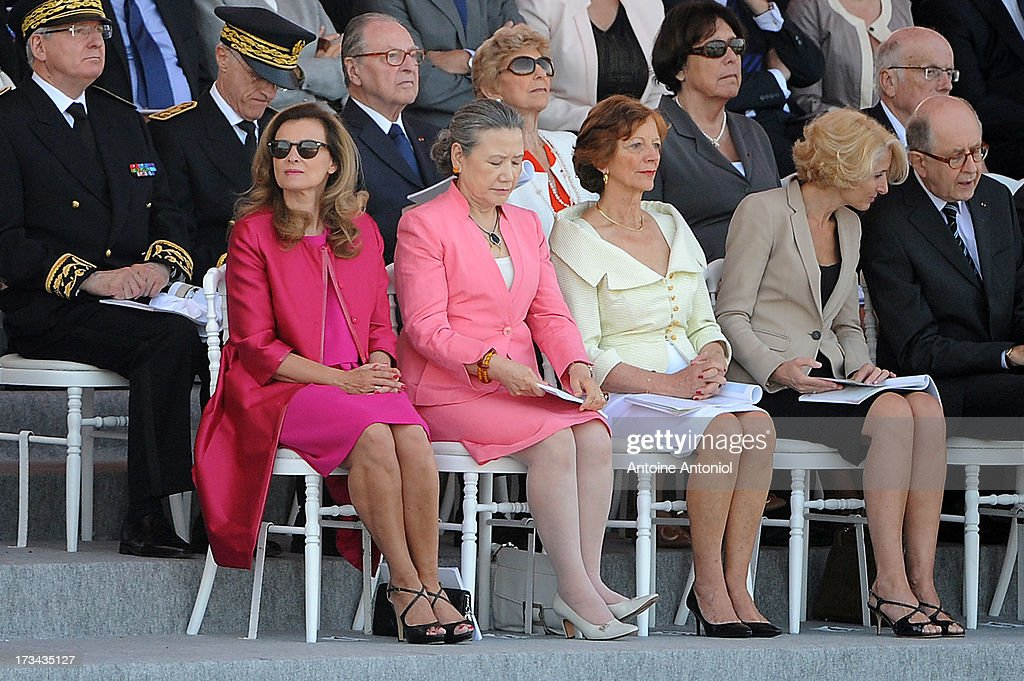 The partner of French President <a gi-track='captionPersonalityLinkClicked' href=/galleries/search?phrase=Valerie+Trierweiler&family=editorial&specificpeople=8534231 ng-click='$event.stopPropagation()'>Valerie Trierweiler</a> (L) and the wife of the United Nations Secretary-General Ban Ki-Moon Yoo soon-taek (2nd-L) attend the Bastille Day parade on the Champs Elysees on July 14, 2013 in Paris, France. The annual military ceremony is the largest in Europe remembering the 'Fete de la Federation' for 1790.
