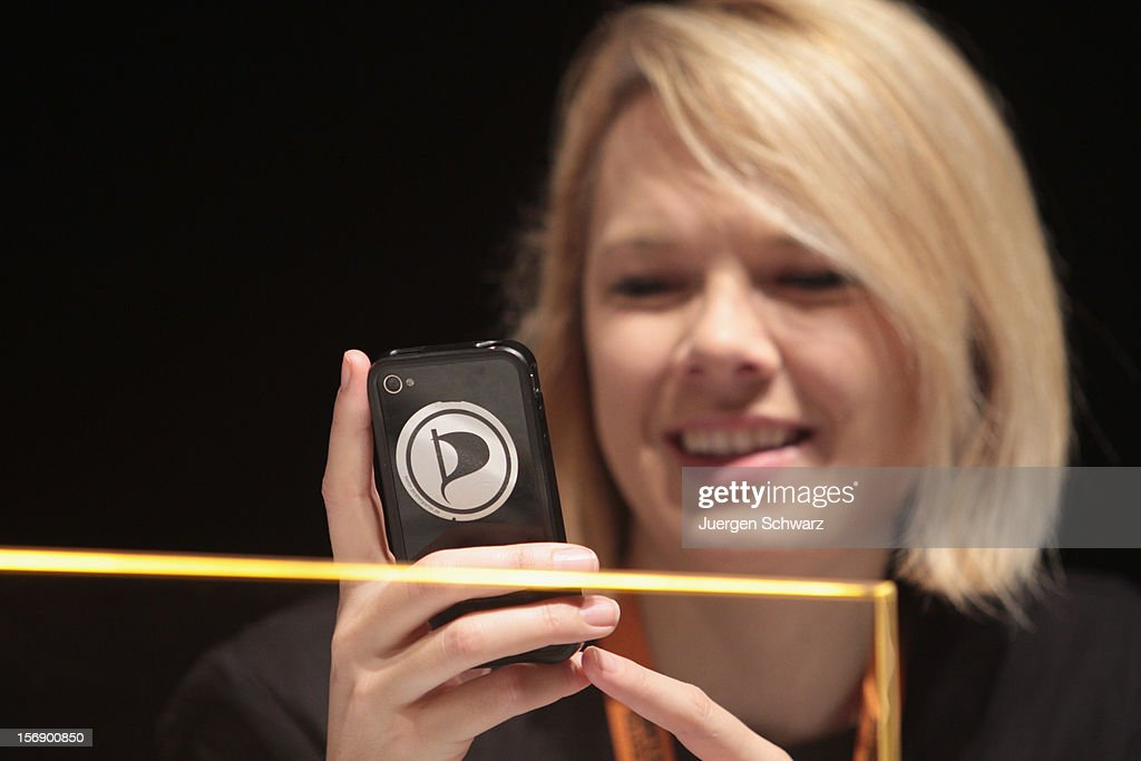 The party logo stuck on the back of the smartphone of Laura Dornheim, at the federal party convention of the German Pirates Party (Die Piratenpartei) on November 24, 2012 in Bochum, Germany. The Pirates, after riding an initial surge in popularity last year that landed them seats in several German state parliaments, have since seen their popularity erode as recent scandals and infighting have tarnished the party's image. Germany faces federal elections in 2013.