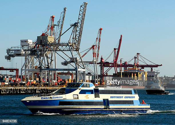 The passenger ferry to Rottnest Island leaves the Port of Freemantle Australia December 31 2005 as container ships are loaded at the terminal in the...