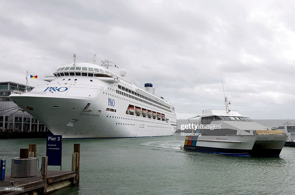 The passenger liner Pacific Dawn, operated by Carnival Corp.'s P&O Cruises, left, sits docked at the Overseas Passenger Terminal at Princes Wharf in Auckland, New Zealand, on Tuesday, March 19, 2013. The New Zealand dollar, nicknamed the kiwi, fell against most major peers as the government said the country's most widespread drought in at least 30 years reduces pressure to raise interest rates. Photographer: Brendon O'Hagan/Bloomberg via Getty Images