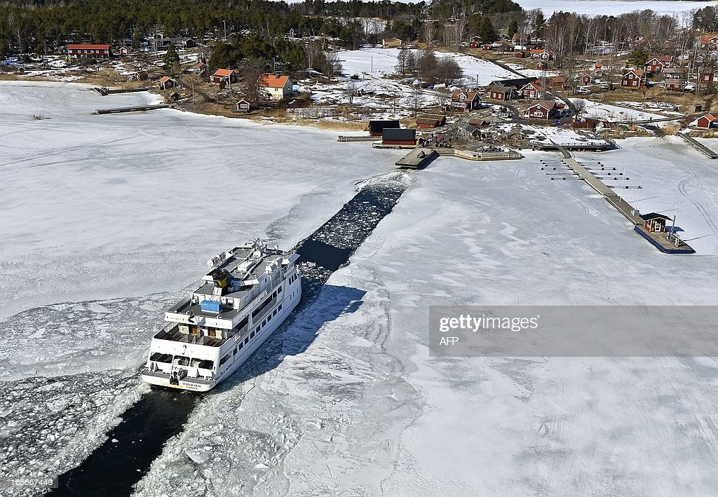 The passenger ship 'Soderarm' slides in a channel through the ice made by an icebreaker for the daily journey to the island Husaro in the Stockholm archipelago in Sweden on April 5, 2013. According to Swedish Metereological and Hydrological Institute (SMHI), the ice coverage in the Baltic is the thickest and most extensive ever.