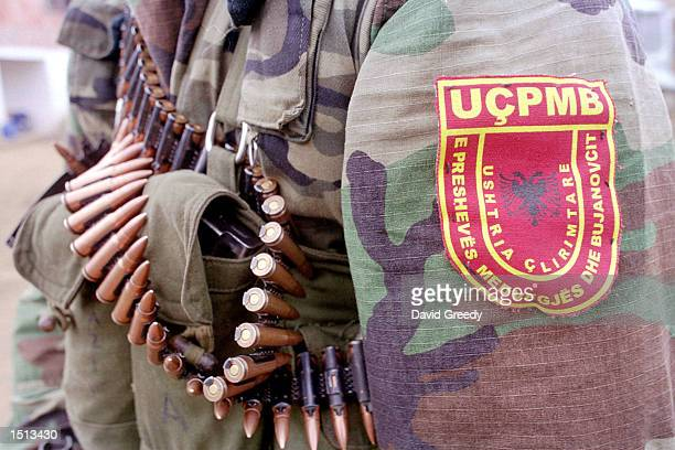 The patch of the Albanian freedom fighters the UCPMB and some of the ammunition which is used to fight the Serbian Military Special Police and...