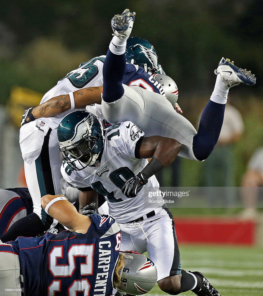 The Patriots' Patrick Chung injured his shoulder on this first quarter play when he hurdled the Eagles Jeremy Maclin (#18) in order to help tackle Philadelphia running back LeSean McCoy (#25). He would leave the game after the play. The New England Patriots hosted the Philadelphia Eagles in an NFL pre season game at Gillette Stadium.