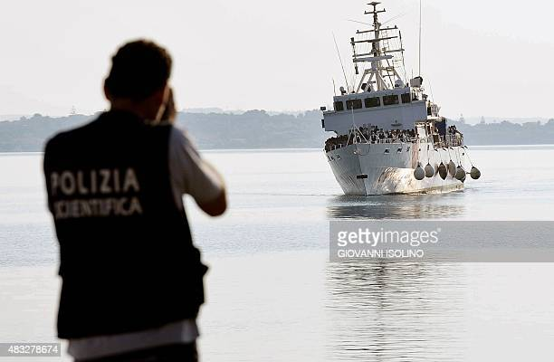 The patrol vessel Fiorillo of the Italian Coast Guard arrives in the port of Pozzallo on August 7 2015 after saving some 387 migrants in the...
