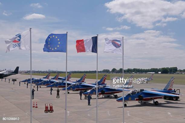 The Patrouille de France line up after an aerial demonstration over the Le Bourget Airport on the first public day of the 52nd International Paris...