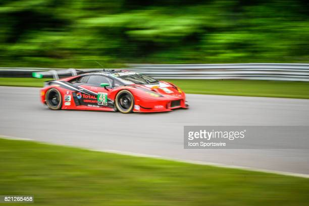 The Paul Miller Racing Lamborghini Huracan GT3 driven by Bryan Sellers and Madison Snow drives down NoName Straight during the IMSA WeatherTech...