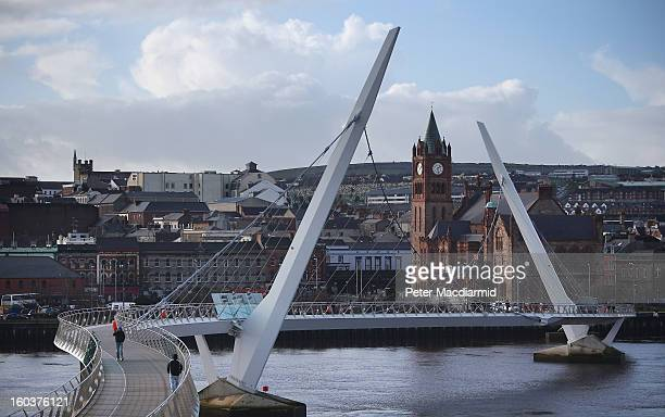 The Peace Bridge crosses the River Foyle in sight of The Guildhall building on January 30 2013 in Londonderry Northern Ireland A year of events have...