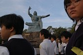 The Peace Statue in Nagasaki was completed in 1955 ten years after the atom bomb struck the city The raised arm points to the threat of nuclear...