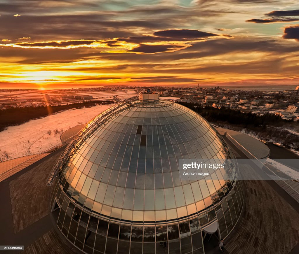 Top view of The Pearl (Perlan) shot using a drone, Reykjavik, Iceland. The Pearl (Perlan) is built on the top of huge tanks in which natural hot water is stored for heating Reykjavik. Restaurants, meeting halls and a museum are housed in the dome.