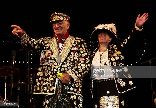 The Pearly King and Queen join Madness on stage in Victoria Park on July 17 2009 in London UK