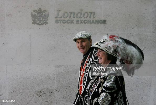 The Pearly King and Queen of Crystal Palace Pat and Carole Jolly walk past the entrance to the London Stock Exchange during a promotion for the...