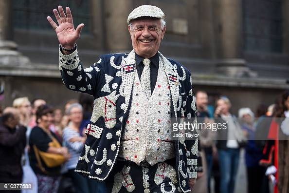 The Pearly King of Mile End waves as he processes towards the Church of St MaryleBow on September 25 2016 in London England The Harvest Festival...