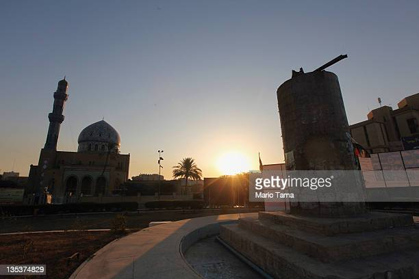 The pedestal upon which the famed statue of Saddam Hussein was toppled on April 9 is seen at sunrise in Firdos Square in front of a mosque on...
