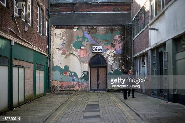 The peeling paint of a mural falls off the wall at the entrance to the closed Public Market in Burslem on February 4 2015 in Burslem StokeonTrent...