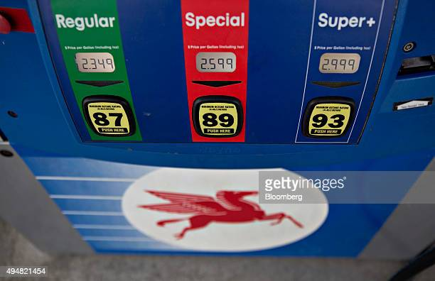 The pegasus horse logo is seen below fuel prices displayed on a pump at an Exxon Mobil Corp gas station in Cherry Valley Illinois US on Wednesday Oct...