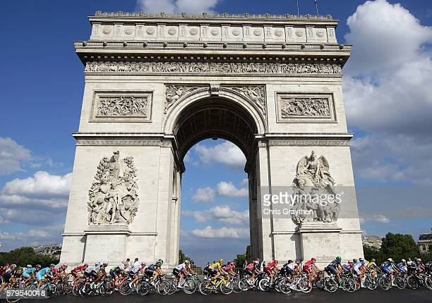 The pelaton cycle around The Arc de Triomph on lap one during stage twenty one of the 2016 Le Tour de France from Chantilly to Paris ChampsElysees on...
