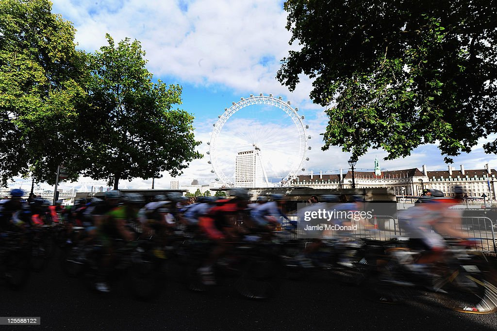 The Pelaton passes the London Eye during Stage Eight of the Tour of Britain at Whitehall, London on September 18, 2011 in London, England.