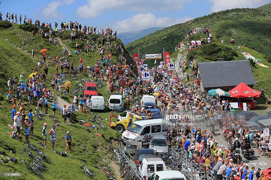 The peloton are cheered on by the crowd as the pass through countryside during stage nine of the 2013 Tour de France, a 168.5KM road stage from Saint-Girons to Bagneres-de-Bigorre, on July 7, 2013 in Bagneres-de-Bigorre, France.