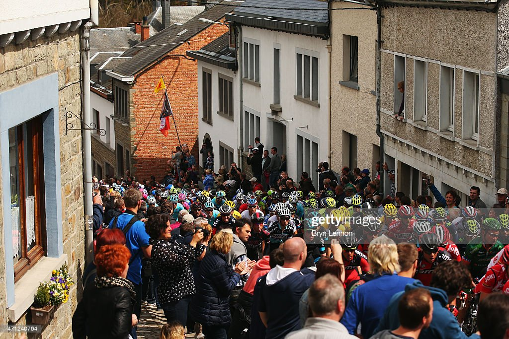 The Peloton begin the climb of Cote de Saint Roch in the town of Houffalize during the 101st LiegeBastogneLiege cycle race on April 26 2015 in...