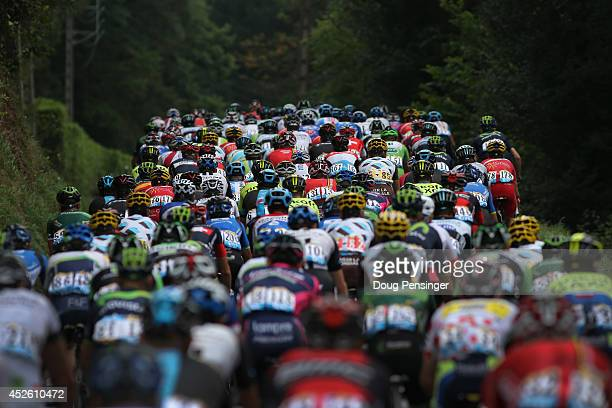 The peloton begins to race at the start of the eighteenth stage of the 2014 Tour de France a 146km stage between Pau and Hautacam on July 24 2014 in...