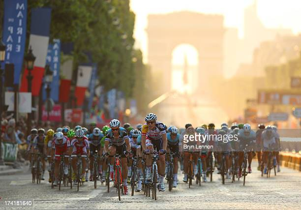 The peloton carges away from the Arc d'Triomphe during the twenty first and final stage of the 2013 Tour de France a processional 1335KM road stage...