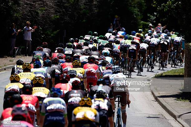 The peloton chases the breakaway during stage seven of the 2015 Tour de France from Livarot to Fougeres on July 10 2015 in Fluere France