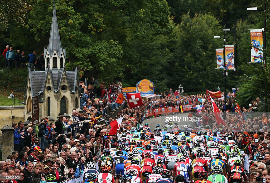 The peloton climb The Cauberg during the Men's Elite Road Race on day eight of the UCI Road World Championships on September 23, 2012 in Valkenburg, Netherlands.
