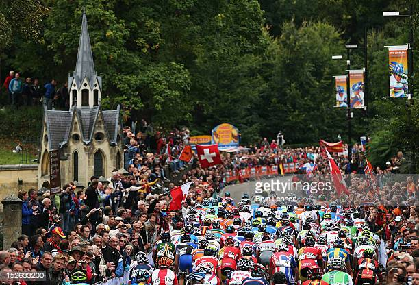 The peloton climb The Cauberg during the Men's Elite Road Race on day eight of the UCI Road World Championships on September 23 2012 in Valkenburg...