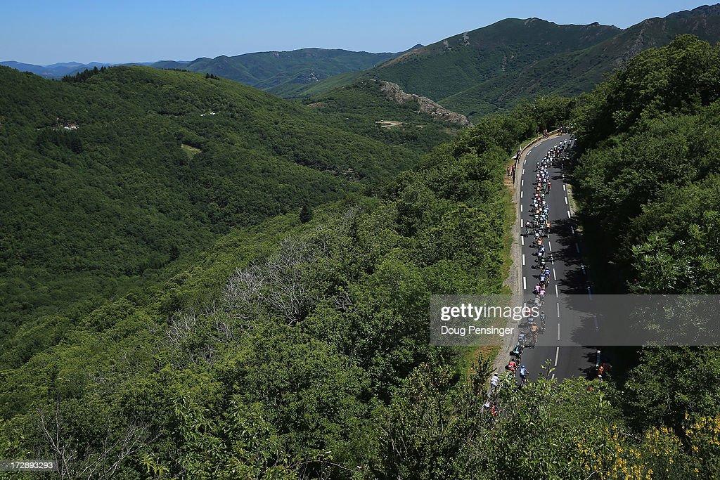 The peloton climbs the Col de la Croix de Mounis during stage seven of the 2013 Tour de France, a 205.5KM road stage from Montpellier to Albi on July 5, 2013 in Saint-Genies-de-Varensal, France.
