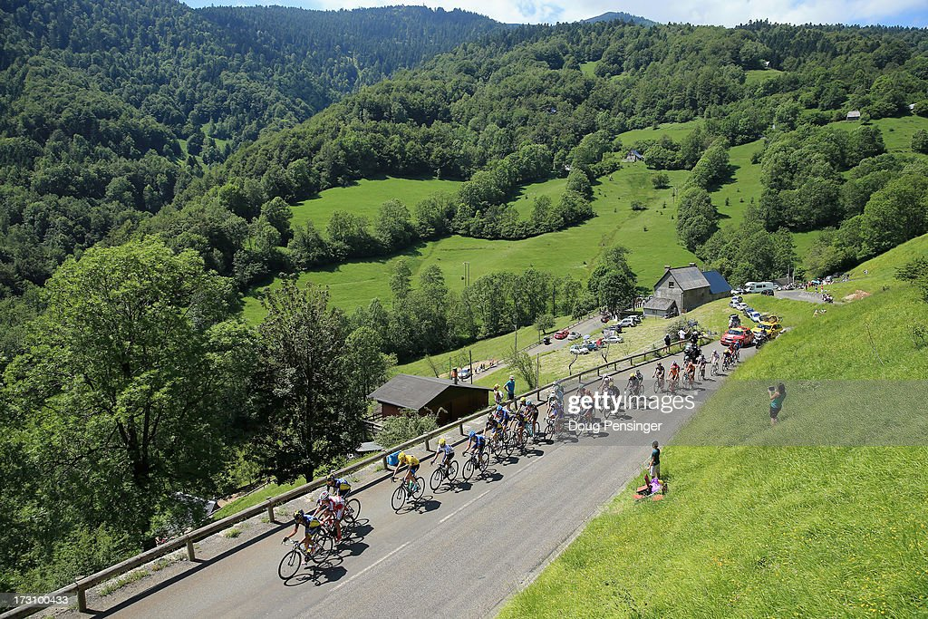 The peloton climbs the Col De Mente during stage nine of the 2013 Tour de France, a 168.5KM road stage from Saint-Girons to Bagneres-de-Bigorre, on July 7, 2013 in Bagneres-de-Bigorre, France.