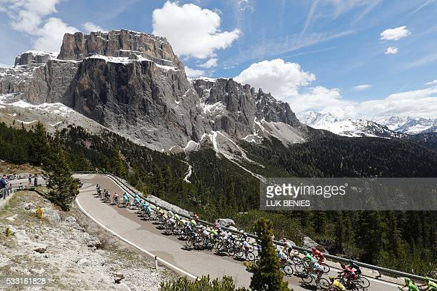 TOPSHOT The peloton climbs the Sella pass during the 14th stage of the 99th Giro d'Italia Tour of Italy from Farra d'Alpago to Corvara on May 21 2016...